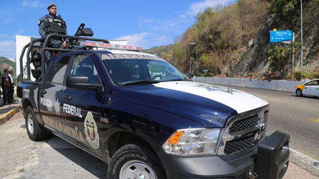 Federal police officers on patrol in Acapulco in March 2015
