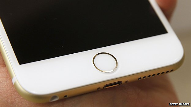 IPhone 6 d'Apple a l'authentification ID d'empreintes digitales tactile intégré dans le bouton d'accueil