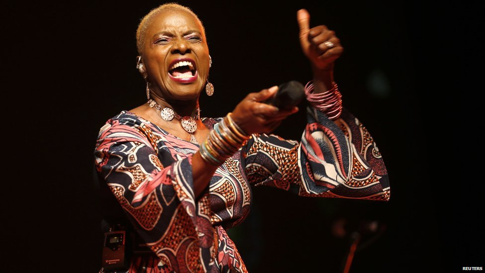 Singer Angelique Kidjo performs on stage at the Etisalat Prize for Literature award ceremony in Lagos 15 March 2015