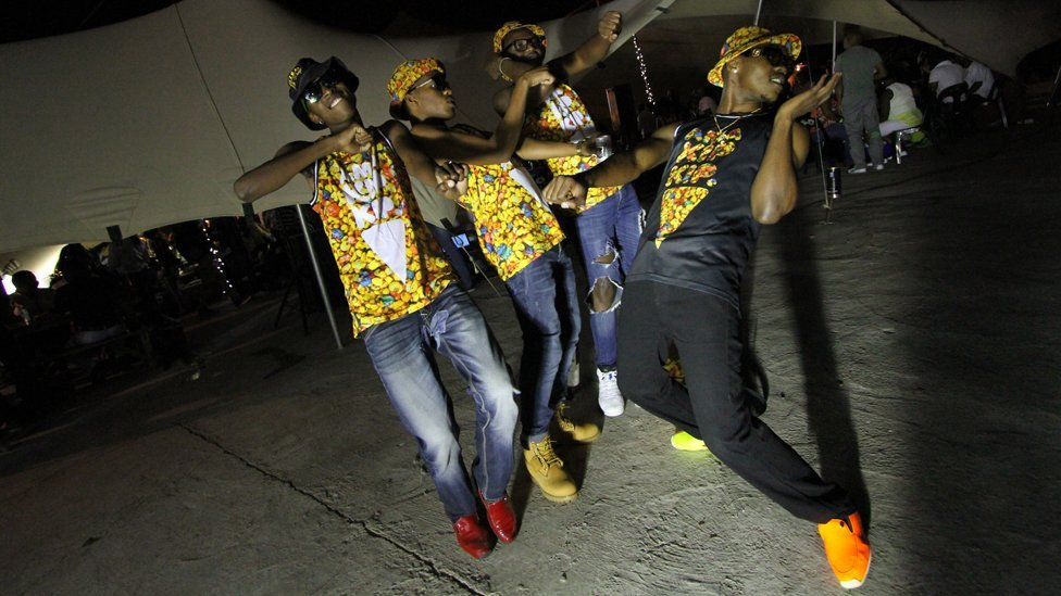 On Saturday, young South Africans dance to house music at a nightclub in Soweto, outside Johannesburg. They are members of a 'commando' of skhothanes, a subculture characterised by their love of expensive clothes and competitive dance