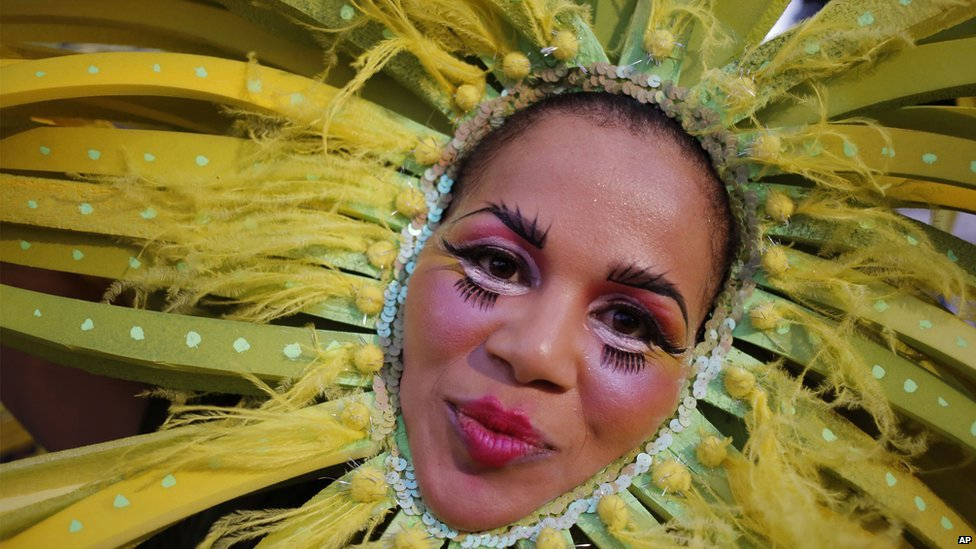 A woman takes part in the yearly Cape Town Carnival held in the city of Cape Town, South Africa, Saturday, 14 March 2015