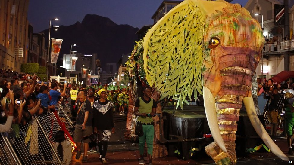 An elephant forms part of the floats at the yearly Cape Town Carnival held in the city of Cape Town, South Africa, Saturday, 14 March  2015