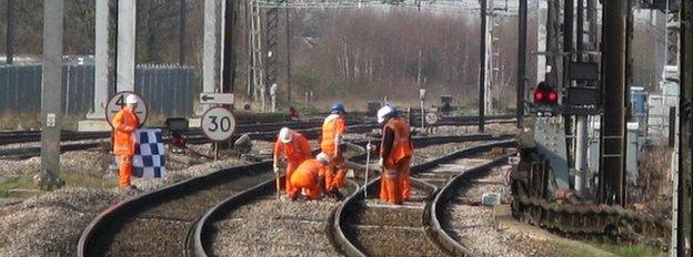 Workmen on a rail line
