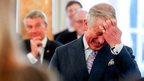 Britain's Prince of Wales laughs