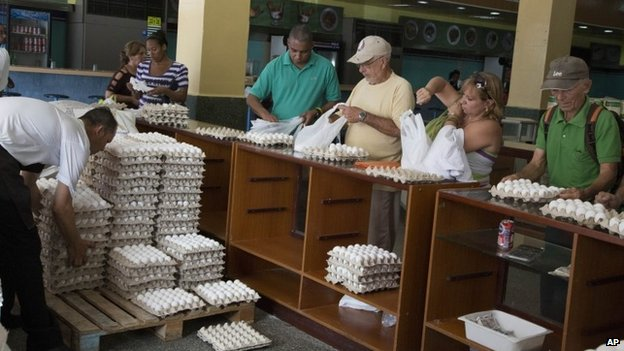 Cubans buy eggs at a state-owned shop in Havana