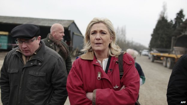 National Front leader Marine Le Pen visits a farm in the French town of Juilley on 20 March 2015