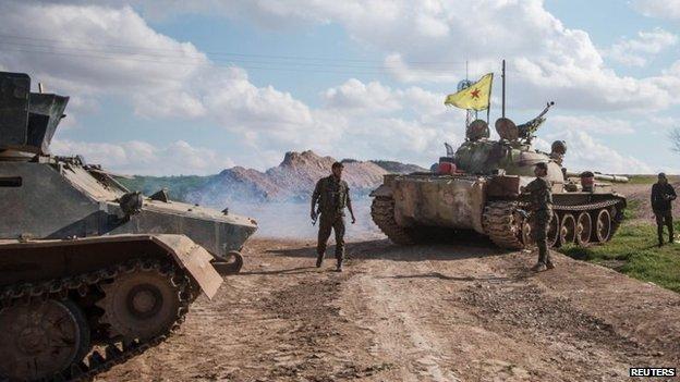 Kurdish YPG militia fighters in Ras al-Ain, Syria