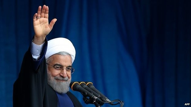 File photo: Iranian President Hassan Rouhani waving to the crowd during a speech in Qom, 25 February 2015
