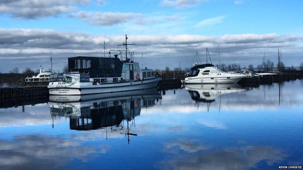 Calm reflective Lough Neagh at Ballinderry