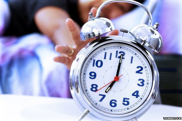 Alarm clock showing seven o'clock