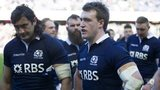 Scotland's Blair Cowan and Stuart Hogg show their disappointment against Ireland