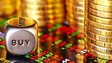 Gold coins and trading screen