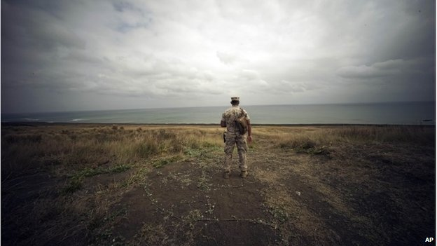 A US Marine looks over Invasion Beach on Iwo Jima (21 March 2015)