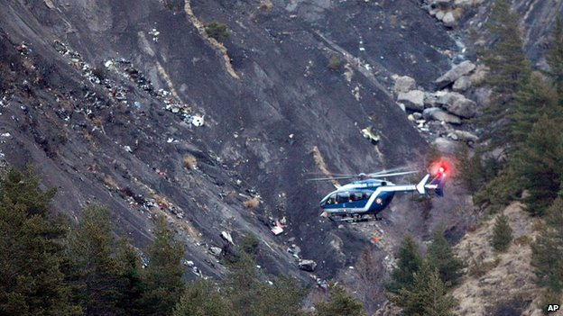 Rescue helicopter at crash site