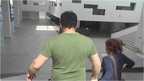 Couple running from museum