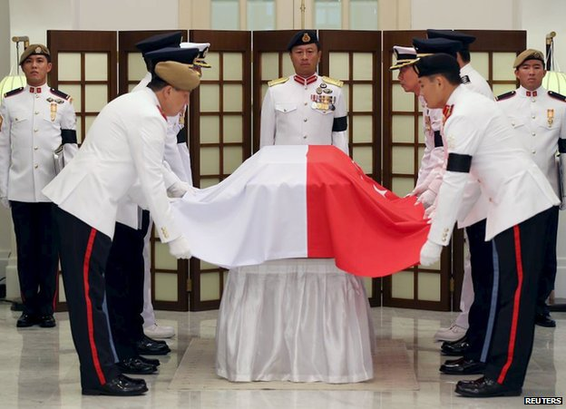 The Guard of honour drapes  Singapore's national flag over the coffin of the late first prime minister Lee Kuan Yew