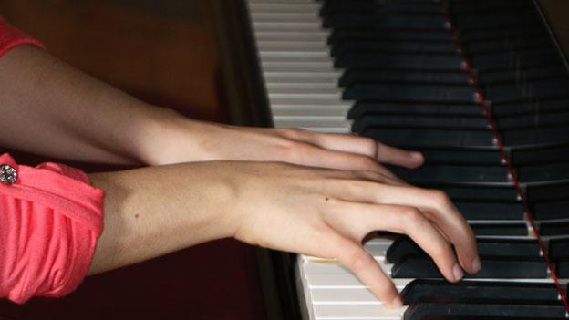Teenager playing piano