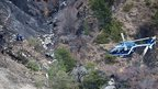 A French helicopter flies over the crash site. Photo: 25 March 2015