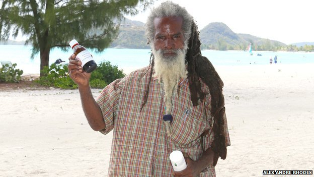 """Sylvester Tyrone """"Amu"""" Motley holds up some of his herbal remedies"""
