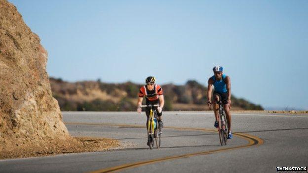 Fit men cycling