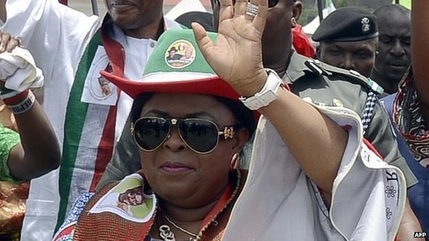Wife of Nigerian President and candidate of the ruling People's Democratic Party (PDP) Patience Jonathan (C) waves as she campaigns for her husband, Goodluck, during a rally ahead of national election in Akure, Ondo State in southwestern Nigeria, on 24 March 2015