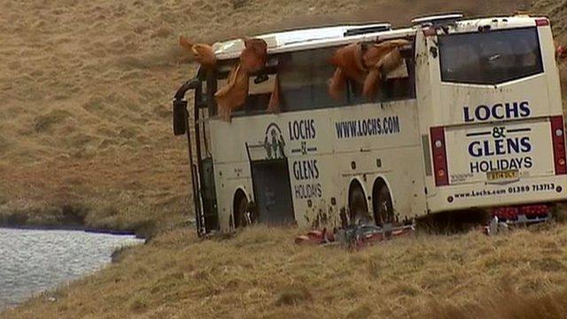 Bus by loch; curtains blowing through broken windows