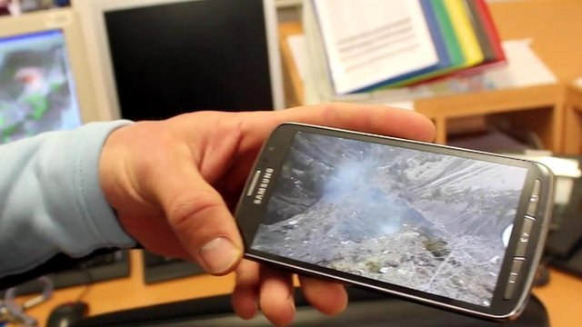 Jean Sebastien Beaud shows the BBC a photo of the crash site using his phone