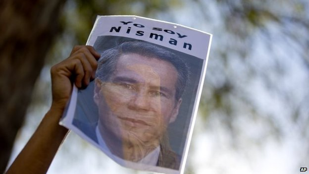 "A demonstrator holds a sign that reads in Spanish ""I am Nisman"" during an act to demand justice following the death of special prosecutor Alberto Nisman, outside the court house in Buenos Aires, Argentina, Wednesday, March 18, 2015"