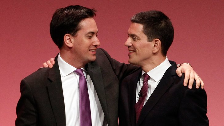 Ed Miliband (L) and David Miliband (R) embrace at Labour Party conference in September 2010