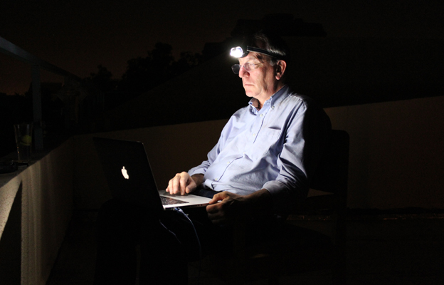 Mark Doyle working late at night in Mali