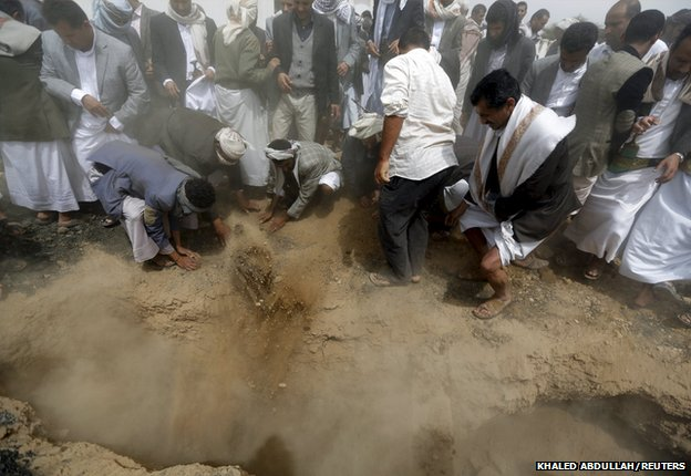 Mourners bury the body of Bashar Arhab in Sanaa