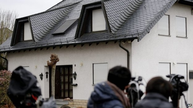 Journalists wait in front of the house of the family of Andreas Lubitz in Montabaur, Germany, Friday, March 27, 2015. L