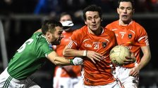 Fermanagh's Ryan McCluskey tackles Armagh forward Jamie Clarke in the recent drawn game at the Athletic Grounds