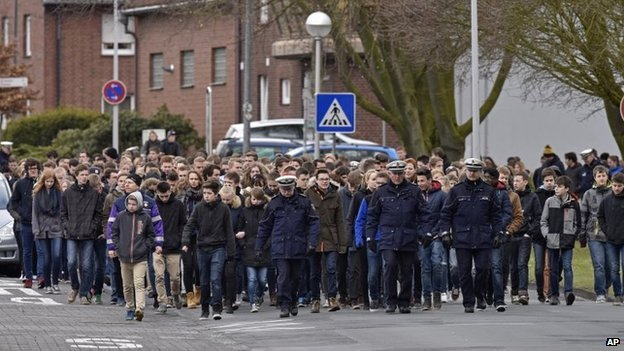 Students of the Joseph-Koenig Gymnasium arrive for a memorial service in Haltern, Germany, on Friday