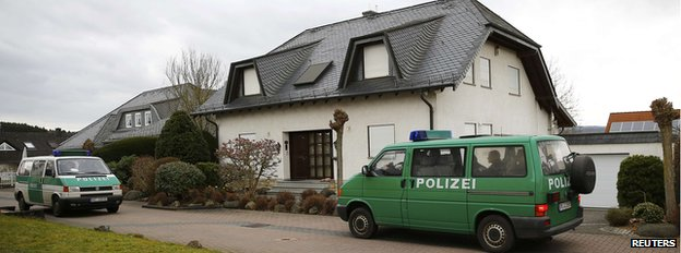 Police vans outside Andreas Lubitz's home on 27 March