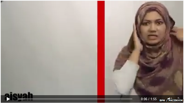 "In the video, Aisyah ""crosses the border"" into Kelantan and finds herself involuntarily donning a headscarf"