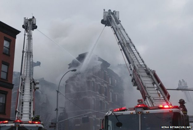 New York firefighters battle a fire at a commercial and residential block