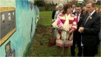 Enda Kenny laid flowers at the site in Ballymurphy where the shooting took place in August 1971