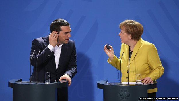 German Chancellor Angela Merkel and Greek Prime Minister Alexis Tsipras speak to the media following talks at the Chancellery in Berlin.