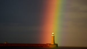 A rainbow appears over the lighthouse at Tynemouth