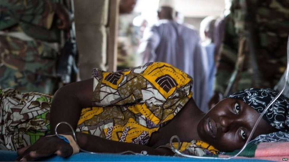 A young woman lies ill in a makeshift hospital room in Maiduguri on 25 March 2015