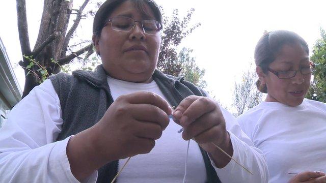 Bolivian women knitting