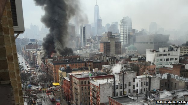 A huge plume of smoke rises from a fire in New York City
