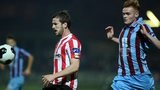 Derry defender Ryan McBride moves ahead of Drogheda's Gareth Bradley
