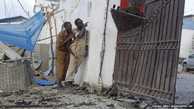 Somali soldiers take position after an attack on a hotel in Mogadishu Somalia, Friday, March, 27, 2015