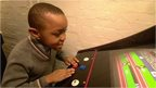 William plays arcade game