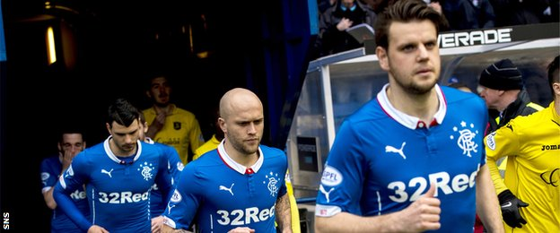 Rangers players running out the tunnel at Ibrox