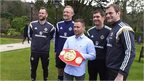VIDEO: Frampton swaps fists for football