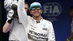 Lewis Hamilton celebrates qualifying in pole position