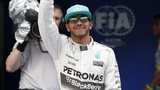 Lewis Hamilton celebrates qualifying in pole position